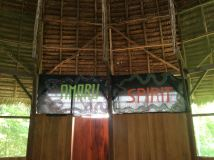 Amaru Spirit banners above the door to the bathroom