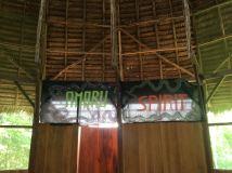 Amaru Spirit banners above the door to the bathroom